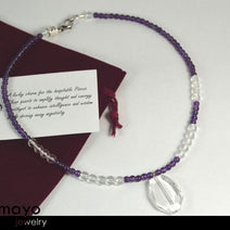 "PISCES NECKLACE <span class=""subtitle"">- Clear Quartz Pendant and Purple Amethyst Beads </span><span class=""findings"">- Stainless Steel Findings </span><span class=""length"">- 18 Inches </span>"
