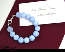 "BLUE CHALCEDONY BRACELET <span class=""subtitle"">- Large Round Beads </span><span class=""findings"">- Stainless Steel Findings </span><span class=""length"">- 8 Inches </span>"