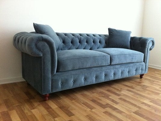 Kenzie sofa with nailheads and Nellie legs.