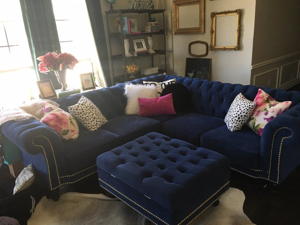 Cipriano blue L shaped sectional and diamond tufted storage ottoman.