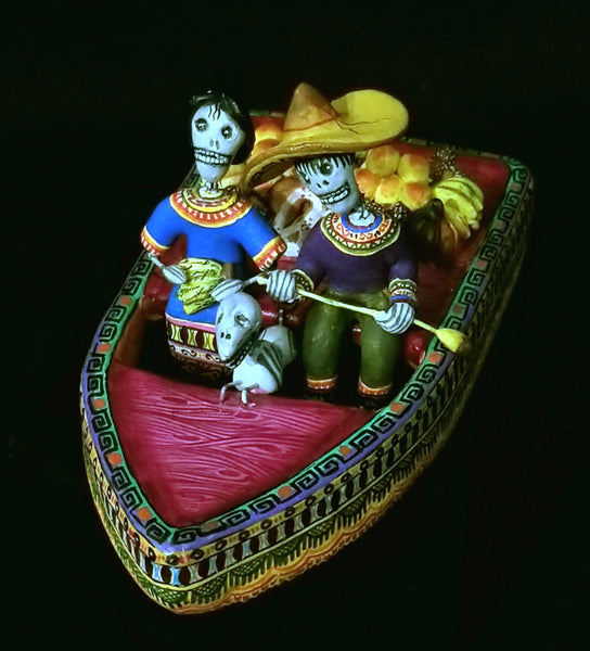 Skeleton Couple and their dog in a rowboat
