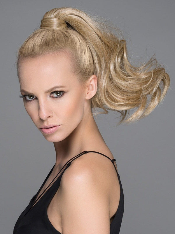 Create a thick, natural ponytail with a little bit of curl!
