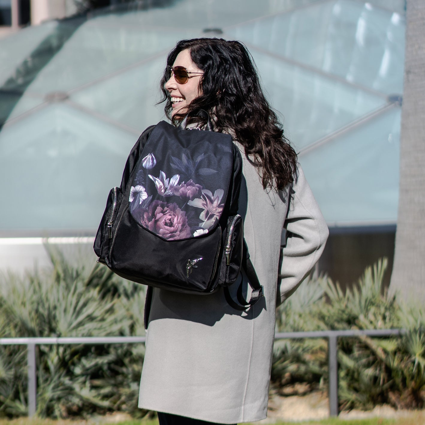 Laptop bag by GraceTech featuring the Dark Floral Print on our Laptop Backpack with a separate computer section.