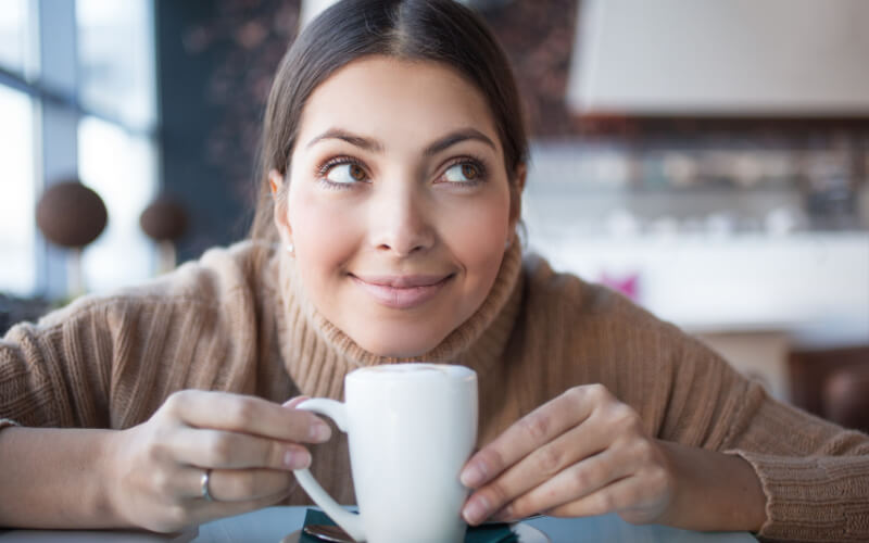 Is Coffee Good For Your Skin woman with cup of coffee
