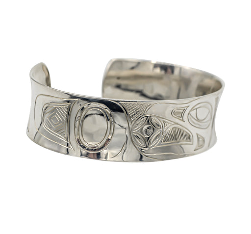 """Raven Stealing the Sun"" Hand Engraved Sterling Silver Bracelet - The Shotridge Collection"