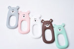 A collection of bear shaped silicone teether pendants for teething babies