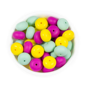 Abacus shaped silicone teething beads that are yellow, fuchsia and mint in colour
