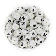 Silicone square letter teething beads that have both capital and lower case font