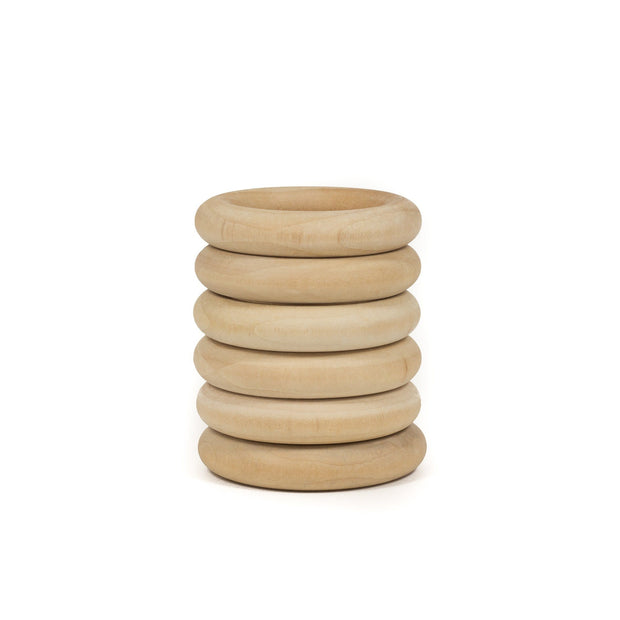 "Natural maple wood teething rings that are 3"" in diameter"