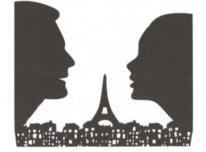 Couple looking over Paris skyline silhouette