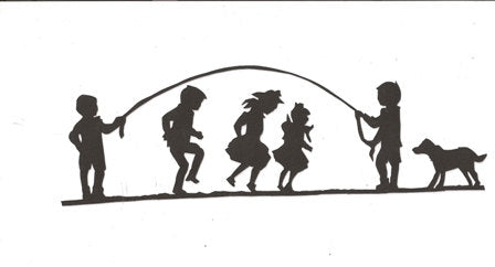 Children playing a game of jump rope silhouette