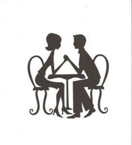 Couple sitting at table silhouette