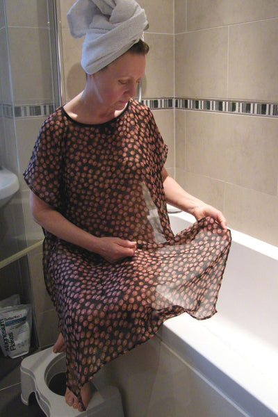 Black/Tan cherries NeverNaked(tm) Shower Drapron® / dementia dignity showering cape drapes over shoulders to be left on whilst showering so dignity is maintained