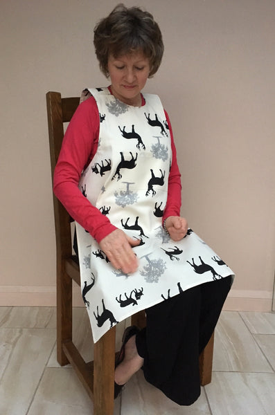 Smart Dining Drapron® to protect clothes in later stage dementia. So much better than an adult bib. Black and white deer pattern ideal as a Christmas gift