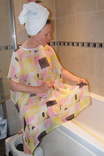 Modesty Bath wear and Modesty Shower wear Lemon/Pink NeverNaked(tm) Shower Drapron® provides dignity whilst being helped to shower