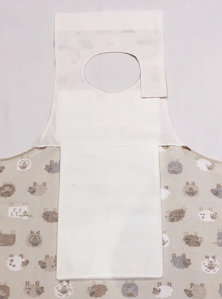 REverse of Sheep design dining drArpron® showing three layers of protection