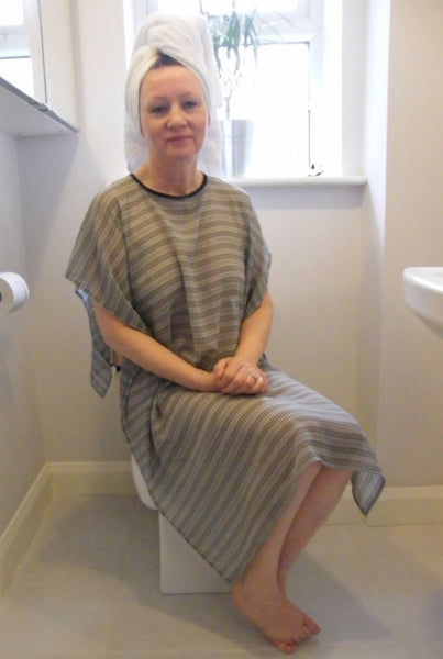 Shower Drapron® drapes over shoulders like a cape to be left on whilst showering so dignity is maintained Black/White check