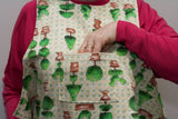 Showing pocket on topiary design dining drApron / clothing protector. So much more dignified and attractive than an adult bib. Looks equally good on men and women