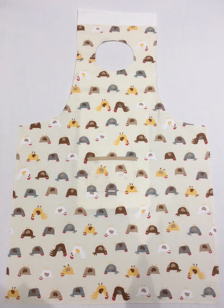 Flat shot of Chickens pattern dining drApron® showing apron shape of the clothing protector and neat neckline