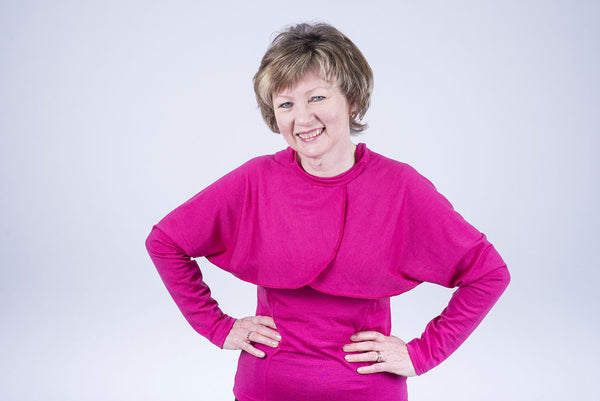 Fuchsia Fine merino sleeves worn as a bolero Easy to put on and off Long sleeves open from elbow to under arm for ease of putting on Also available in black and turquoise