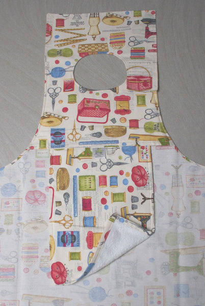 Showing protective towelling layer on back of Sewing Accessories design Dining Drapron / clothing protector. So much better than an adult bib Colourful pictures of sewing accessories