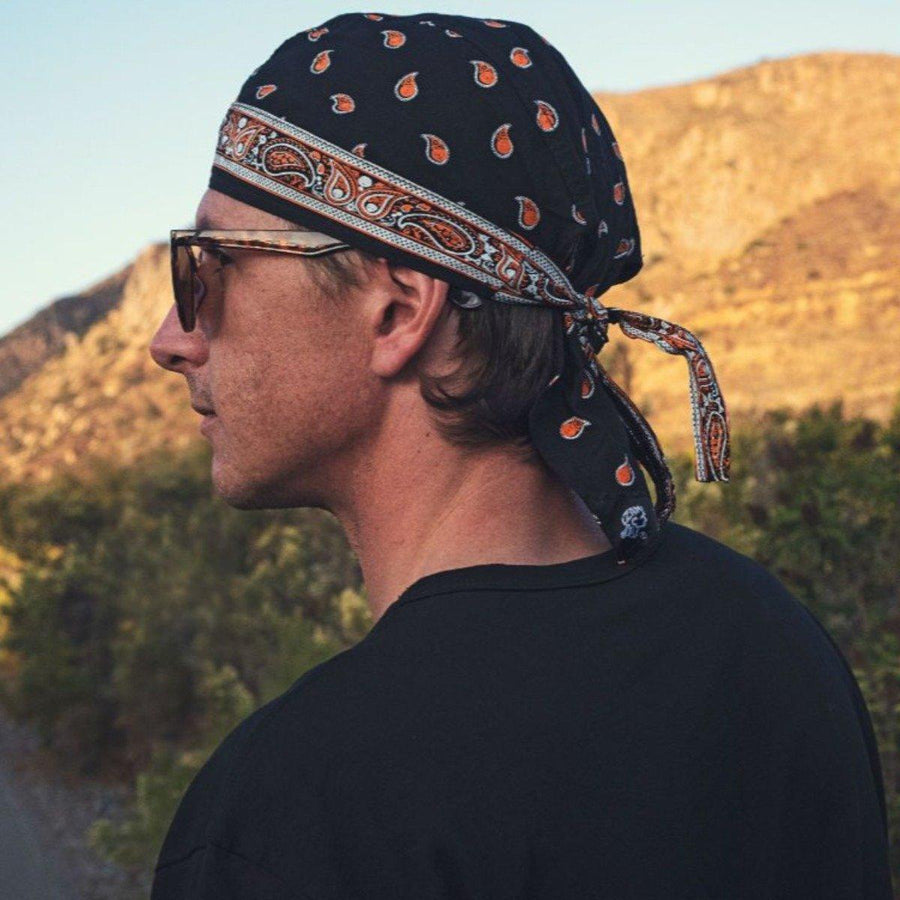 ZANheadgear® Classic Black Bandana with White & Orange Pattern, 50+ UV Protection