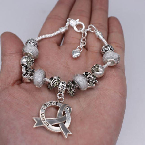 Brain Cancer Awareness Luxury Charm Bracelet in hand