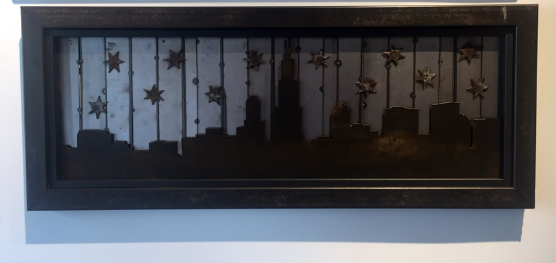 Chicago Skyline light rust raised off of striped backing with stars - Arc Academy
