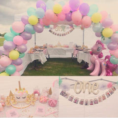One giant party balloon and 12 months garland