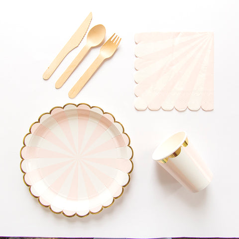 Pink paper party plates, cutlery, cups and napkins