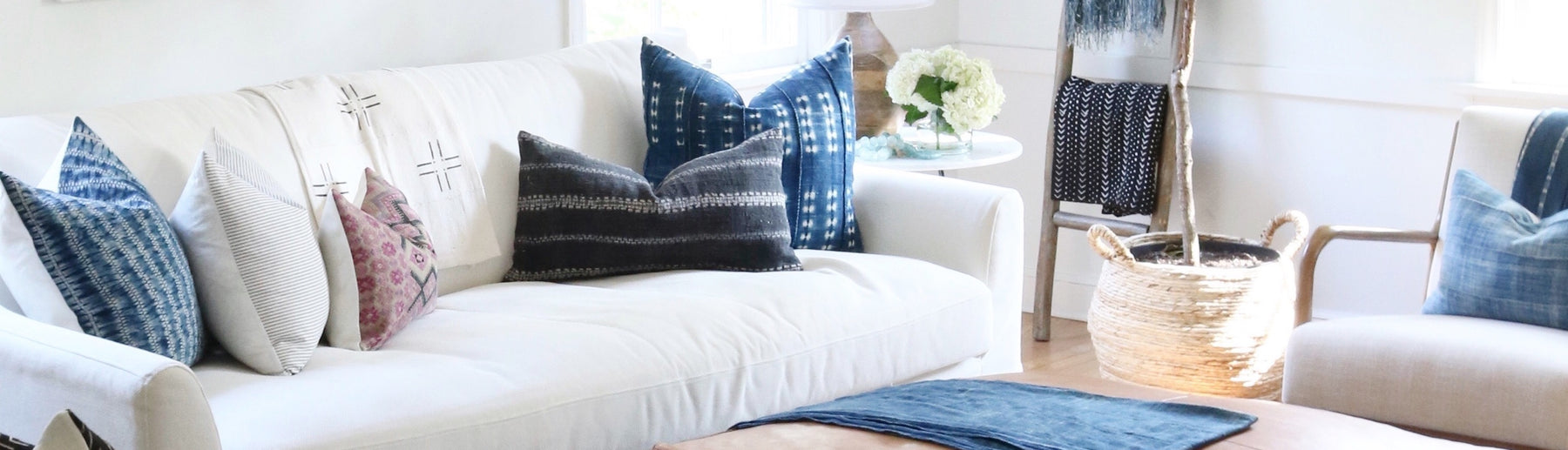 Handmade Designer Pillow Covers-Danielle Oakey Shop Site Home Page Banner Image. Pillows On a white couch.