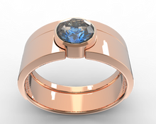 bezel ring set in rose gold and blue sapphire