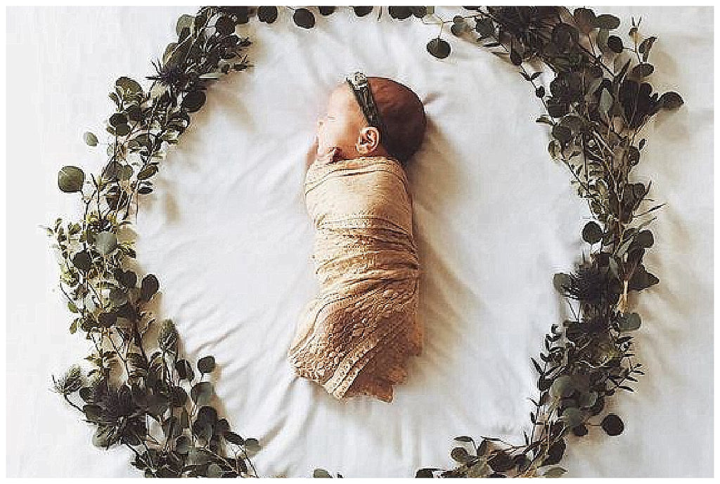 Floral wreath newborn photography trend