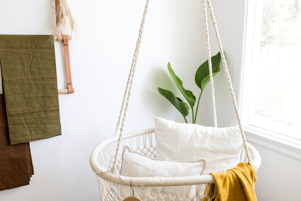 boho babe nursery range, unisex nursery with hanging macrame bassinet by little willow vintage