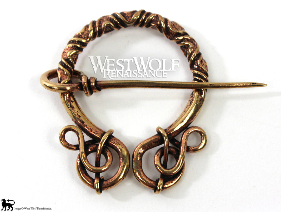 Bronze Penannular Brooch with Twists and Curls