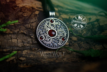 Eagle Head Triskele Pendant in Sterling Silver with Red Garnet Stones