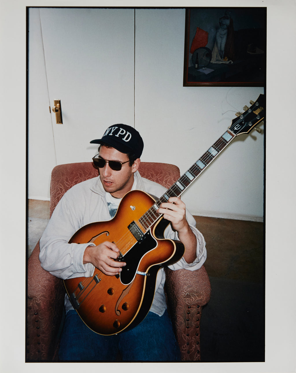 Adam Sandler playing an Epiphone guitar - Original Artist Print by Dewey Nicks