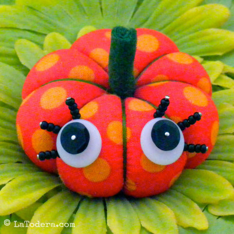 fabric Pumpkin Pincushion with button eyes