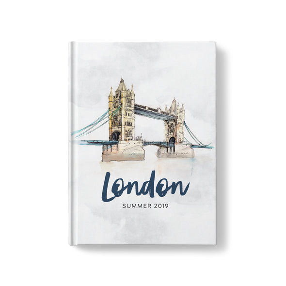 hardcover travel journal with watercolor illustrations of world landmarks