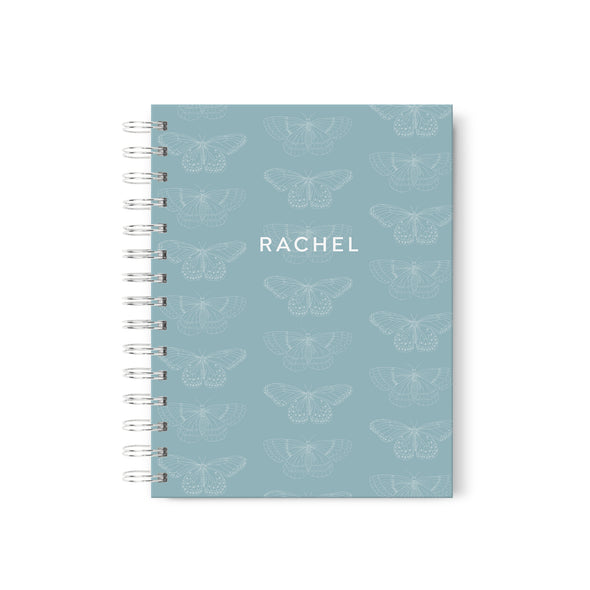Hardcover spiral-bound journal with butterflies and personalized with your name