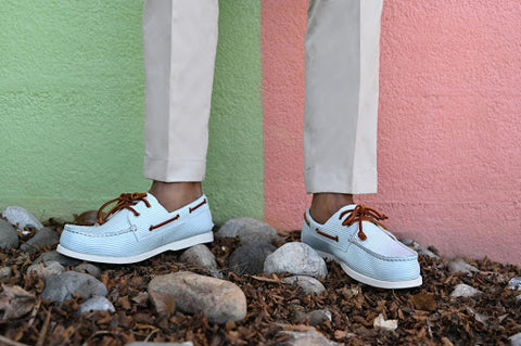 man wearing baby blue boat shoes