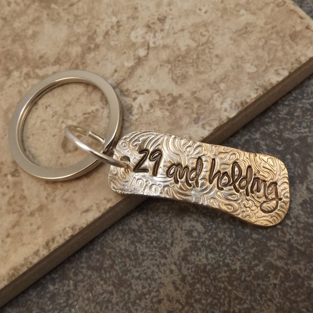 29 and Holding Keychain 1