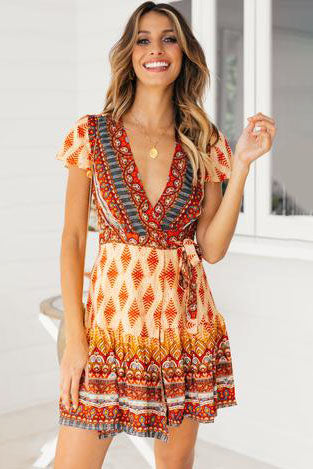 Girl wearing thhe Alannah Boho Mini Dress and gold coin necklaces.