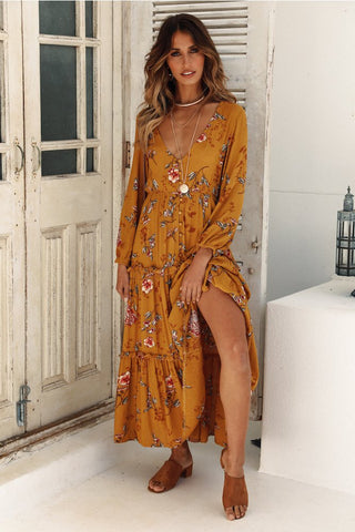 Girl wearing the Adela Boho Maxi Dress, camel color sandals and gold jewelries.