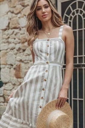 Girl wearing the Arathea Striped Midi Dress, layered jewelries and straw hat.