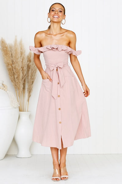 Girl wearing the pink Wynona Off Shoulder Midi Dress, strappy sandals and the boho hoop earrings.