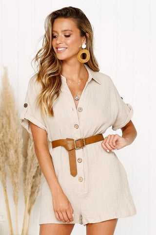 Girl wearing the khaki Sicily Buttoned Casual Playsuit, tan belt and boho jewelries.