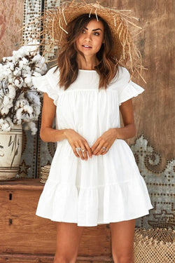 Girl wearing the white Darla Tiered Babydoll Dress, straw hat and silver toned rings.