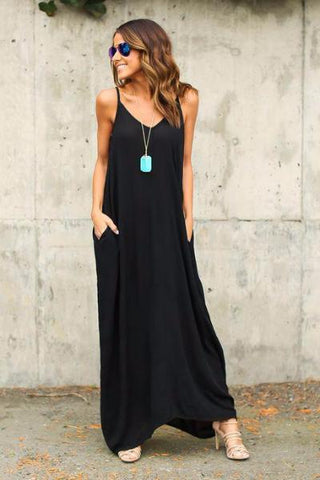 Girl wearing the black Shelia Pocketed Maxi Dress, aviator sunglasses, nude sandals and boho necklace.