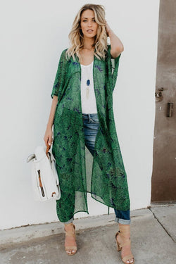 Girl wearing the Adelpha Green Envy Kimono, white top, jeans, nude sandals and boho jeweled necklace.